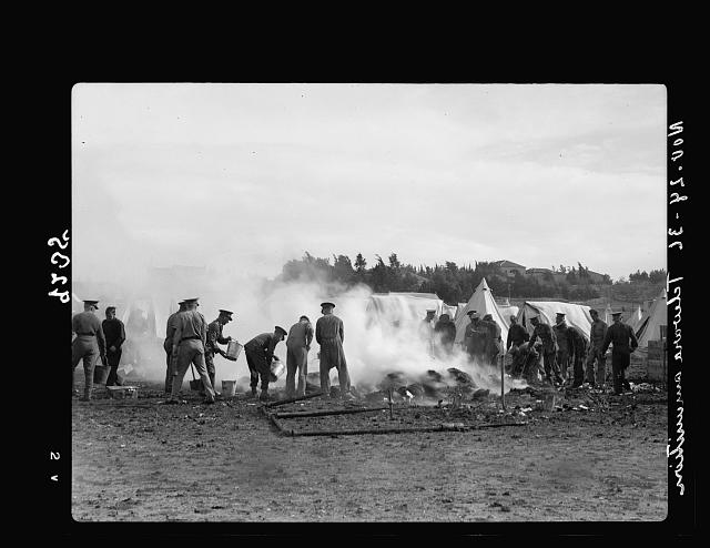 Palestine disturbances 1936. Tommies putting off fire caused by explosion of ammunition near Talavera Barracks, Jerusalem