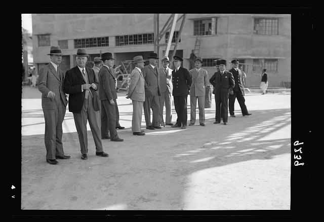 Palestine disturbances 1936. Members of the Royal Commission visiting the Jaffa Custom House. Group is looking at the new Jaffa break-water, which is being explained by the Port Officer and the District Comissioner, Mr. Crosbie