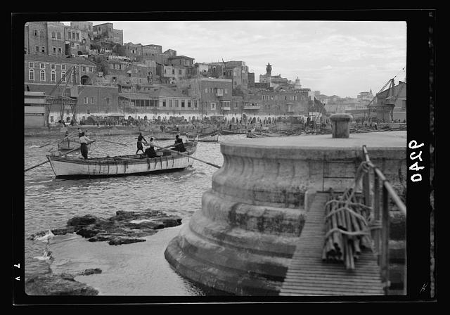 Palestine disturbances 1936. New Jaffa sea-front, as seen from the seaward end of the new break-water, at the right. View is looking across the lighter port. House of Simon the Tanner is to the right of the distant minaret