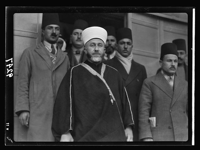 Palestine Disturbances. The Grand Mufti. Haj Amin eff. el-Husseini, with attendants, leaving the offices of the Palestine Royal Commission after giving his evidence