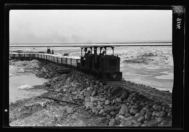 Dead Sea Album, prepared for the Palestine Potash Ltd. A train of carnallite on the first lap of its journey to the European market