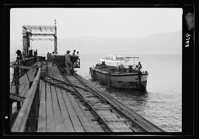 Dead Sea Album, prepared for the Palestine Potash Ltd. The one hundred ton barge being pulled up to the Usdum pier to be loaded with potash for the North
