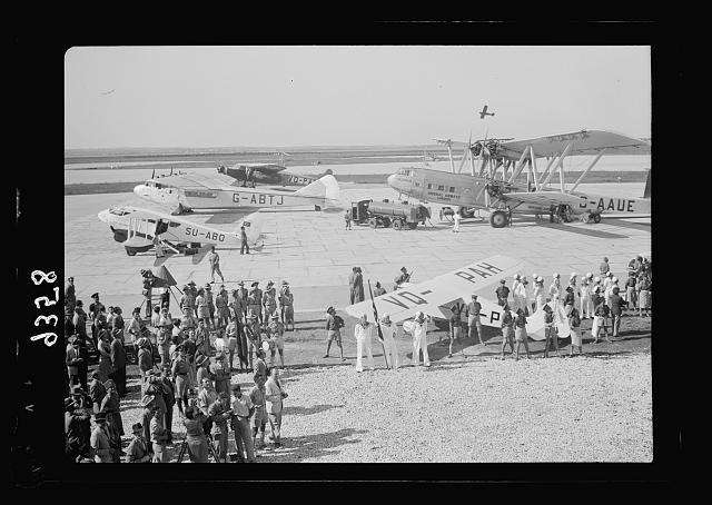 Wings over Palestine-Certificates of Flying School, April 21, 1939. Lydda runway showing air liners, etc., & test plane just taken off [Lydda Air Port]