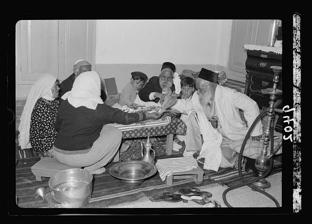Ceremony of eating the Passover, Yemenite family, April 3, 1939. Eating herbs