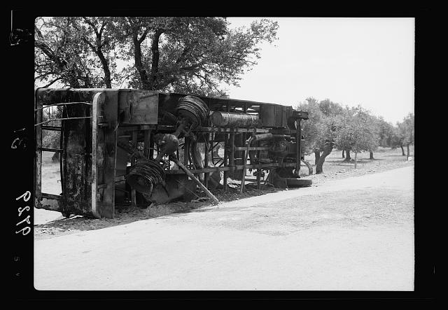Result of terrorist acts & government measures. Remains of a burnt Jewish passenger bus at Balad-Esh-Sheikh outside Haifa
