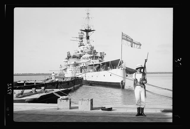 Haifa, result of terrorist acts & government measures. H.M.S. Repulse taken from the docks, marine on guard below British flag