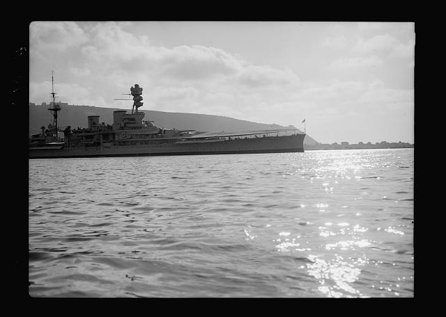 Haifa, result of terrorist acts & government measures. H.M.S. Repulse with Haifa in background, silhouette effect against Mt. Carmel
