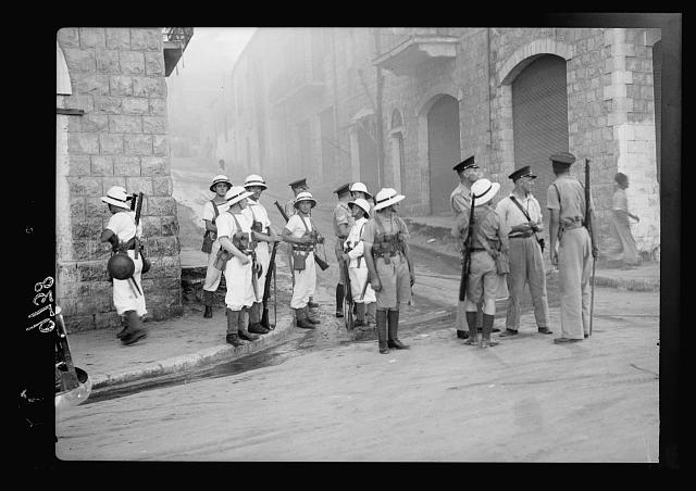 Haifa, result of terrorist acts & government measures. H.M.S. British marines & police in control of Haifa streets during a case of incendiary