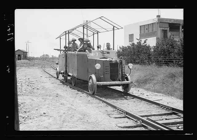 Eleventh Huzars arriving at Ludd. Armoured trolly preceding the troop train of the 11th Huzars