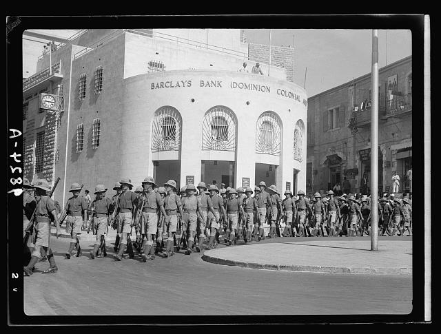 Br. [i.e., British] troops marching passed [i.e., past] Barclay's Bank [Jerusalem]