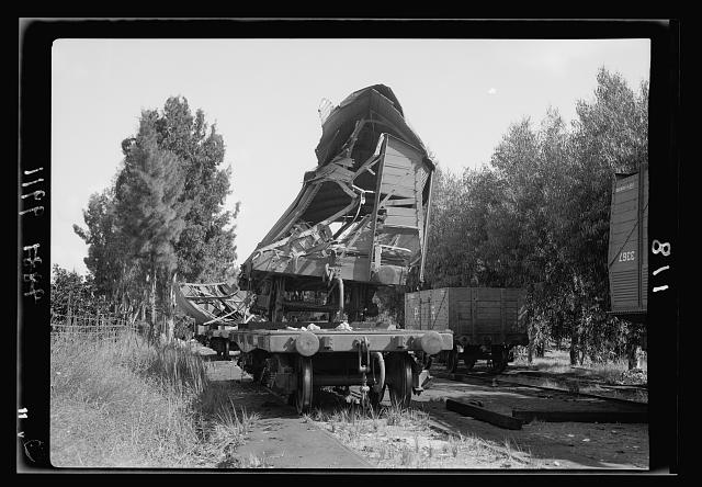 Salvaged rolling stock from R.R. [i.e., railroad] sabotage, 1938