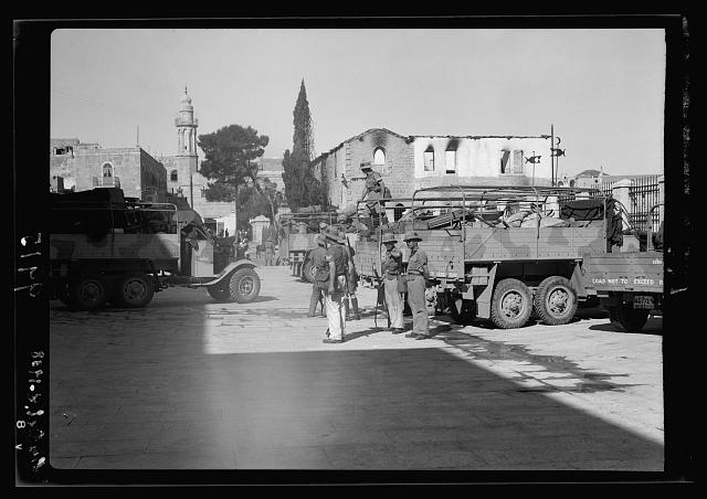 Arrival in Bethlehem of the Worcestershire Rgt. [i.e., Regiment], 1st Br[igade?] showing burned government ofices & police station in background