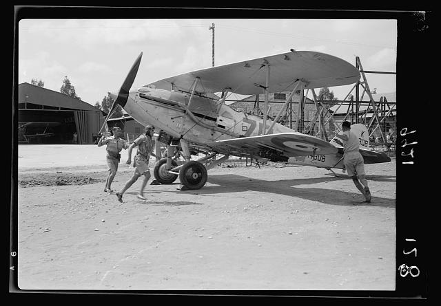 R.A.F. activities. Starting crew & pilot rushing to stand by plane no. 1 [Ramleh Aerodrome]