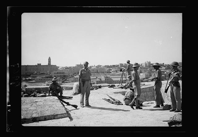 Troops on Tower of David, troops close up showing heliograph in use & the King David hotel in distance. The present G.H.Q. for Palestine operations