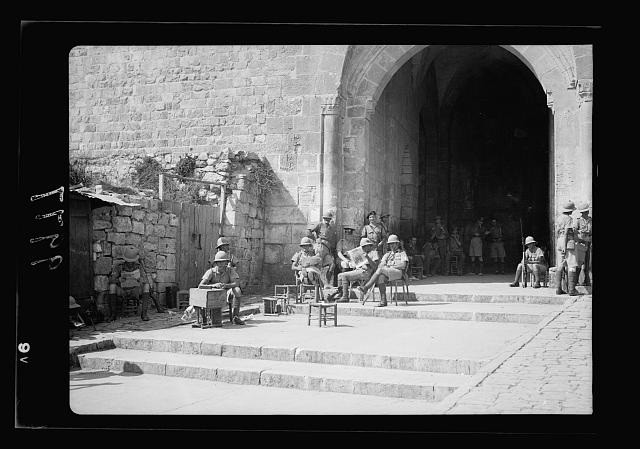 The raising of the siege of Jerusalem. Typical scene of troops in Old City before the lifting of curfew. Scene of troops inside the Damascus Gate