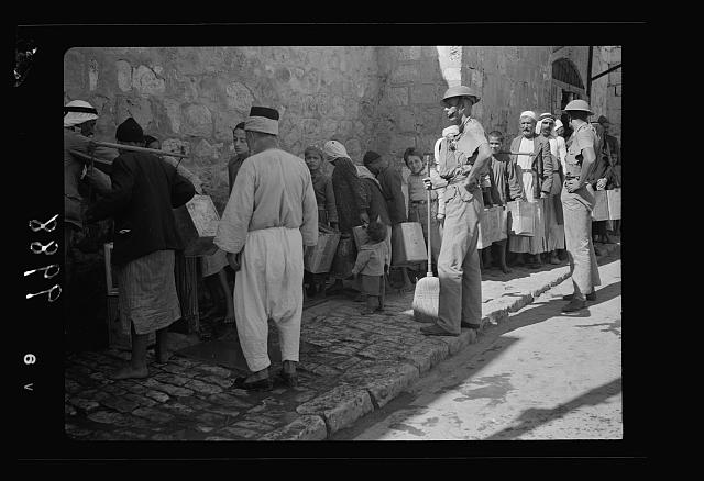 The raising of the siege of Jerusalem. Thirsty people lined up to get their supply of drinking water inside the Old City