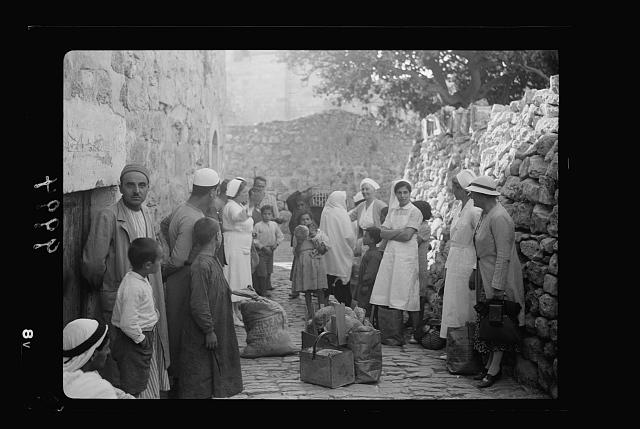 The raising of the siege of Jerusalem. Distribution of bread by the American Colony Association in the streets of Jerusalem