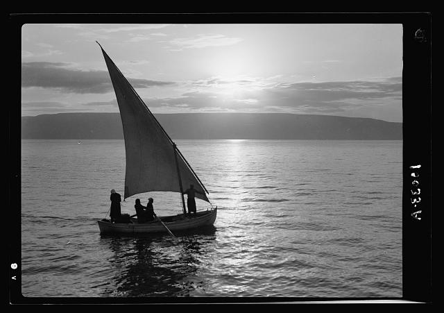 Sunrise scene with sailing-boat on the lake [Sea of Galilee]