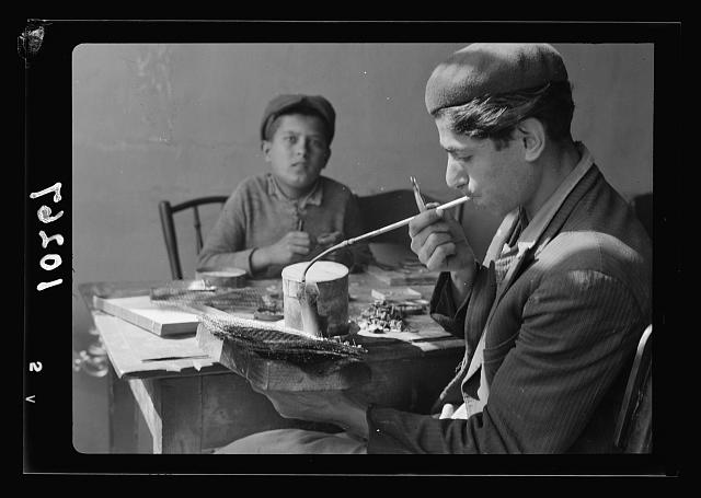 Young Jewish jeweler using the blow-pipe