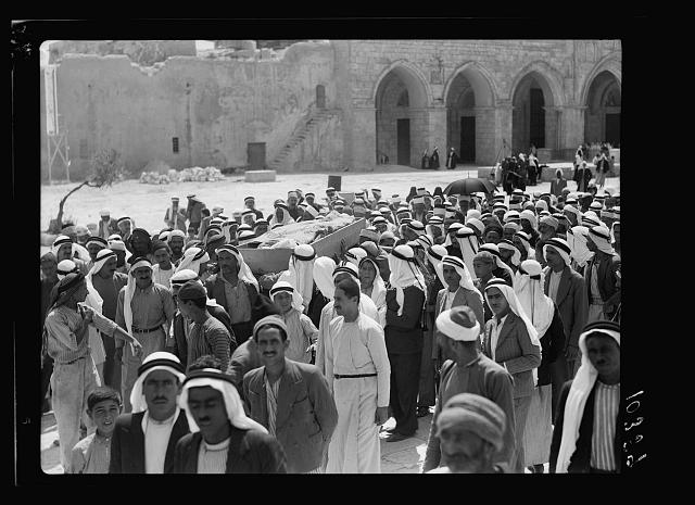 Crowds in the Mosque el-Aksa [i.e., al-Aqsa], showing a victim
