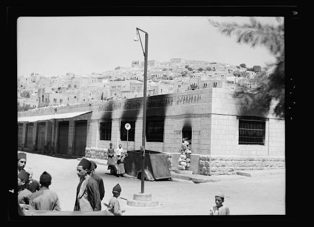 Hebron bank & post office burned by Arab rebels, 8/19/38