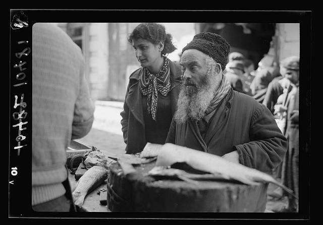 Jewish types. Jewish fishmonger's stall & customers
