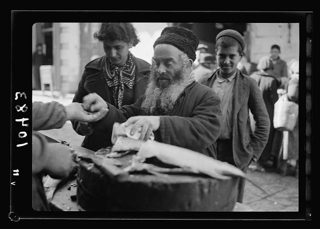 Orthodox Jew buying fish
