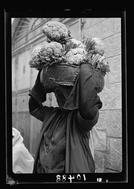 Peasant women carrying cauliflower on her head
