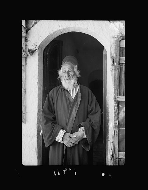 Yemenite Rabbi Shlomo in doorway of his home, the Cabalist