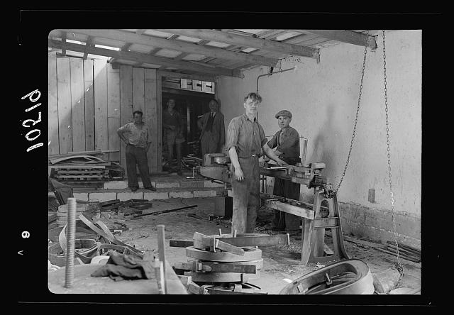 Jewish factories in Palestine on Plain of Sharon & along the coast to Haifa. Bent Furniture Factory in Holon Settlement. Process of bending wood after steaming