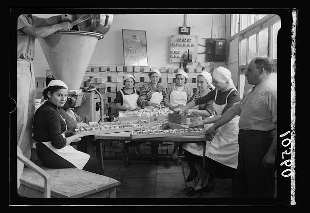Jewish factories in Palestine on Plain of Sharon & along the coast to Haifa. Tel Aviv. Cheese factory. Int[erior]. Hand packing (closer view)