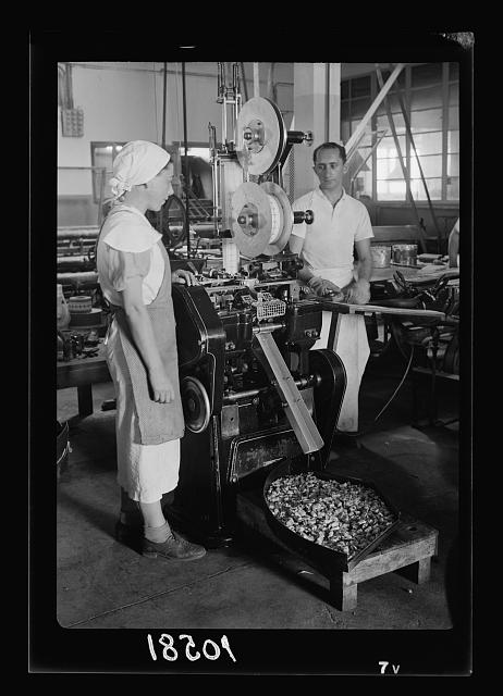 "Jewish factories in Palestine on Plain of Sharon & along the coast to Haifa. Ramath Gan. The ""Elite"" Chocolate Factory, int[erior]. Sweets are wrapped by machine"