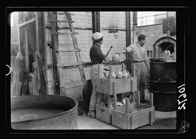 "Jewish factories in Palestine on Plain of Sharon & along the coast to Haifa. Haifa. The ""Kadar"" Ltd. Ceramics. Burnt fine ceramics being taken from kiln"