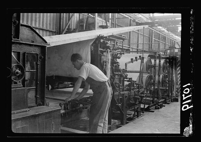"Jewish factories in Palestine on Plain of Sharon & along the coast to Haifa. Near Acre, Kfar-Ata. The ""Ata"" Textile Co. Gluing the warp"