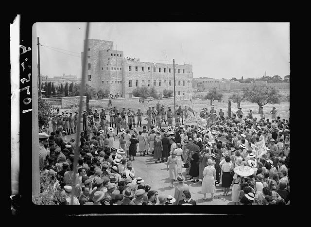 Jewish anti Palestine White Paper demonstrations. [Women's demonstration on May 22, 1939]. Demonstration approaching King David Hotel stopped by cordon of police seen in distance