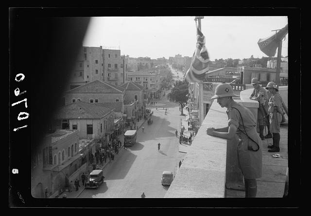 Jewish anti Palestine White Paper demonstrations. [Women's demonstration on May 22, 1939]. Troops on roof of District Commissioner's offices, showing loud speaker & road below [Jerusalem]