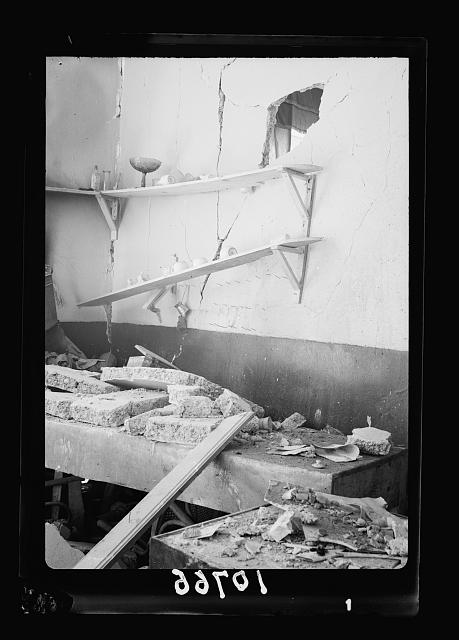 Bomb explosion in Arab café on Mamillah Road in Jerusalem, on June 30 '39, Friday a.[m.]. Wreckage in café caused by explosion, 2 fatal[l]y wounded. 8 others [...]