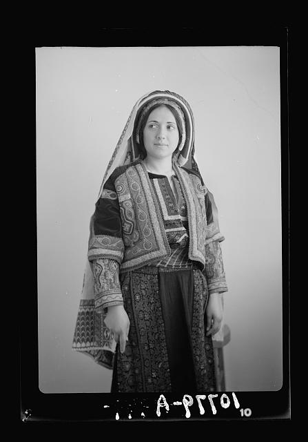Ramallah type (Wedad Khuri). Weddad in finely embroidered Ramallah costume, 3/4 figure