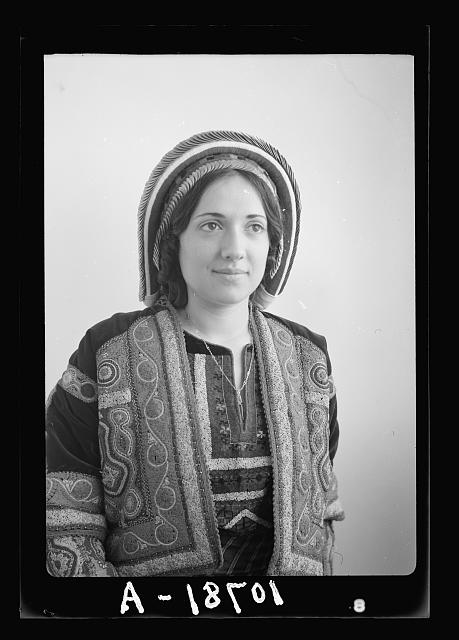 Ramallah type (Wedad Khuri). Weddad in finely embroidered Ramallah costume, bust only