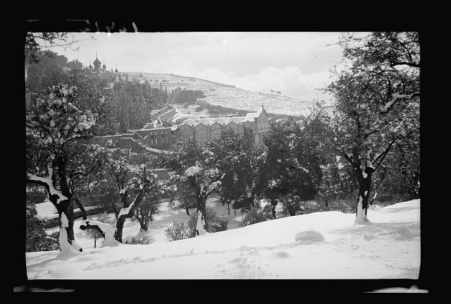 Snow scenes. Garden of Gethsemane showing the Basilica