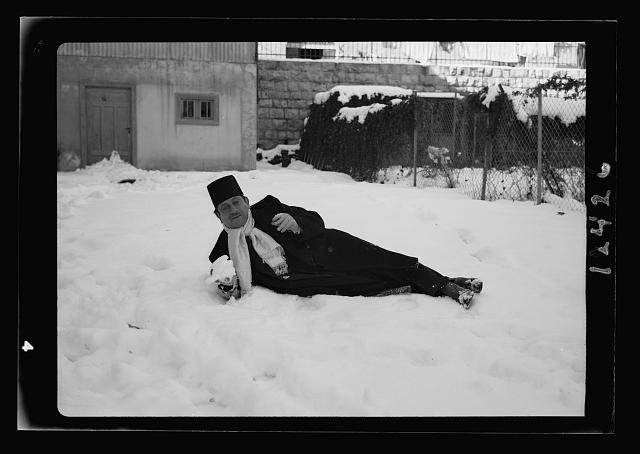 Samy Shawa lying in snow