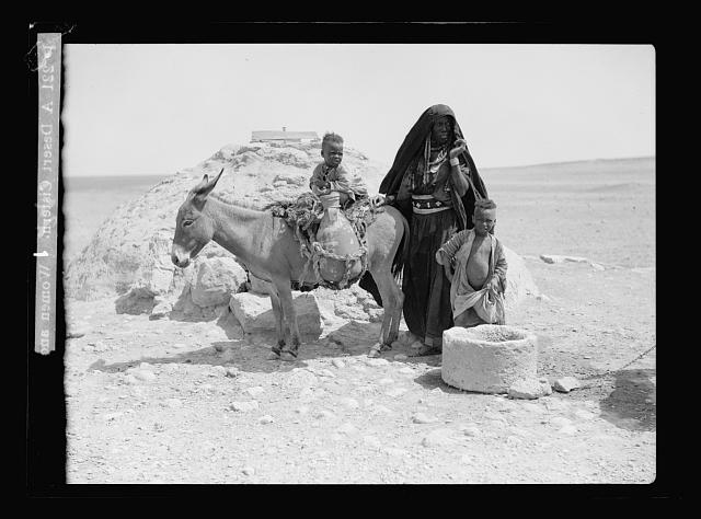 Beersheba Bedouins. A desert cistern. (Women and children with a donkey loaded with water jars)