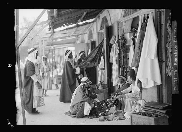 The Beersheba bazaar. (Bedouins bargaining with vendors)