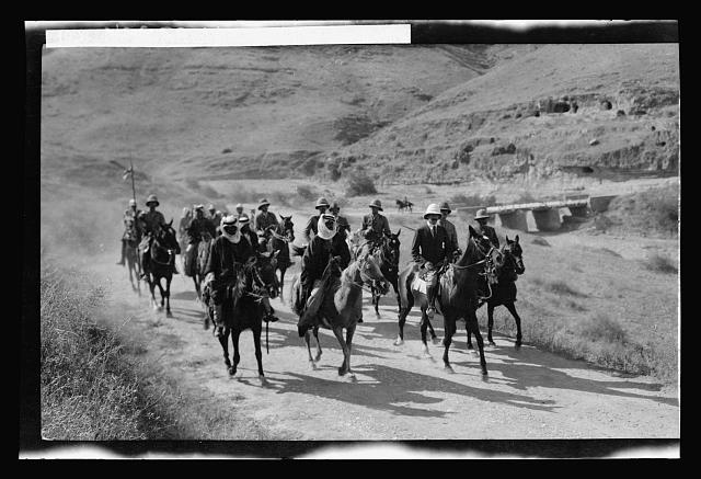 The High Commissioner's first visit to Transjordan. Sir Herbert Samuel with Bedouin escort The High Commissioner's first visit to Transjordan. Sir Herbert Samuel with bedouin escort