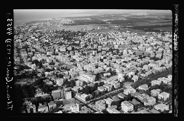 Air views of Palestine. Tel Aviv. Section near the Park Avenue with large synagogue in foreground