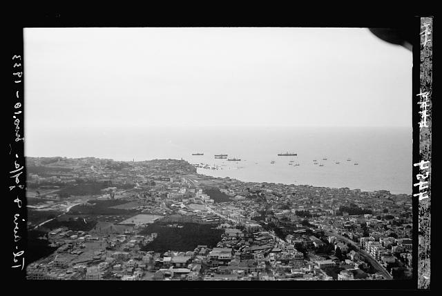 Air views of Palestine. Tel Aviv. Looking toward Jaffa Port, seen in distance with ships at anchor