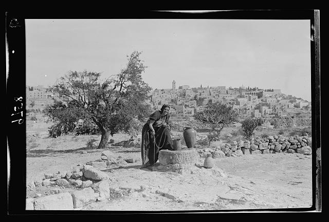 View of Bethlehem from the south. Foreground, Bethlehem woman drawing water. Sofie