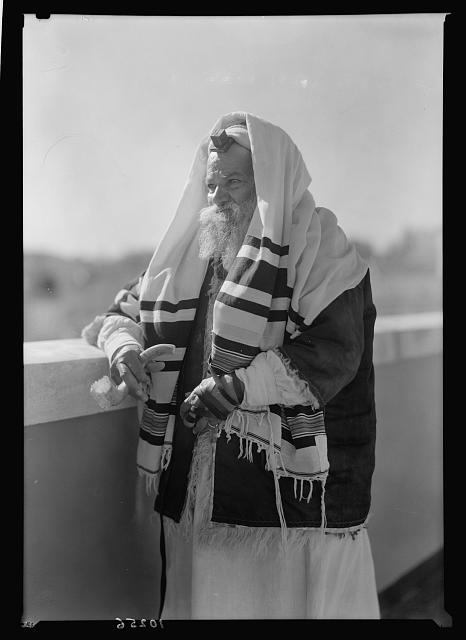 Yemenite Rabbi Avram arrayed for prayer, waiting with shofar in hand to announce the Sabb. [i.e., Sabbath]