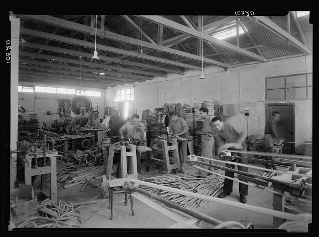 Jewish factories in Palestine on Plain of Sharon & along the coast to Haifa. Bent Furniture Factory in Holon settlement. Dressing chair bottoms by machinery