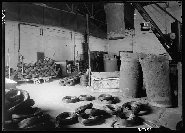 "Jewish factories in Palestine on Plain of Sharon & along the coast to Haifa. Petah-Tikvah. Wire drawing & nail factory. ""Barzelit,"" Ltd. Bundles of wire before being drawn"